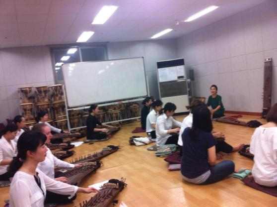 The other gayageum class practicing in the same room as ours at the dress rehearsal. Their teacher seemed a bit more stern/serious.