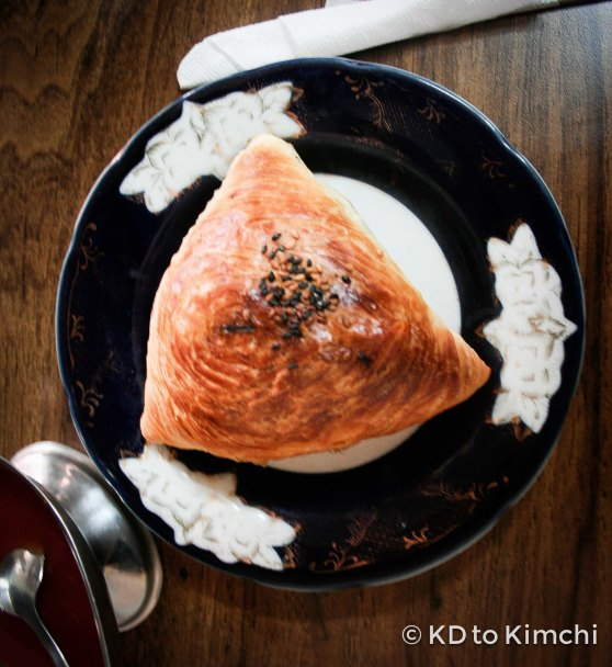 The samsa was made out of flaky pastry, and filled with meat, spices and rice