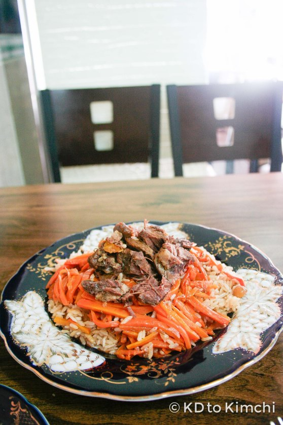 """Plov"" - lamb meat, served on top of sliced carrots and a rice pilaf (7,000w / $7.00)"