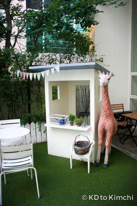 Giraffe and garden in the front