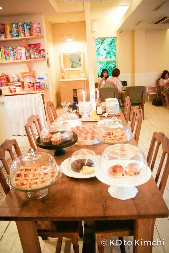 """Table with all the baked goods (pie, """"smile bread"""", etc)"""