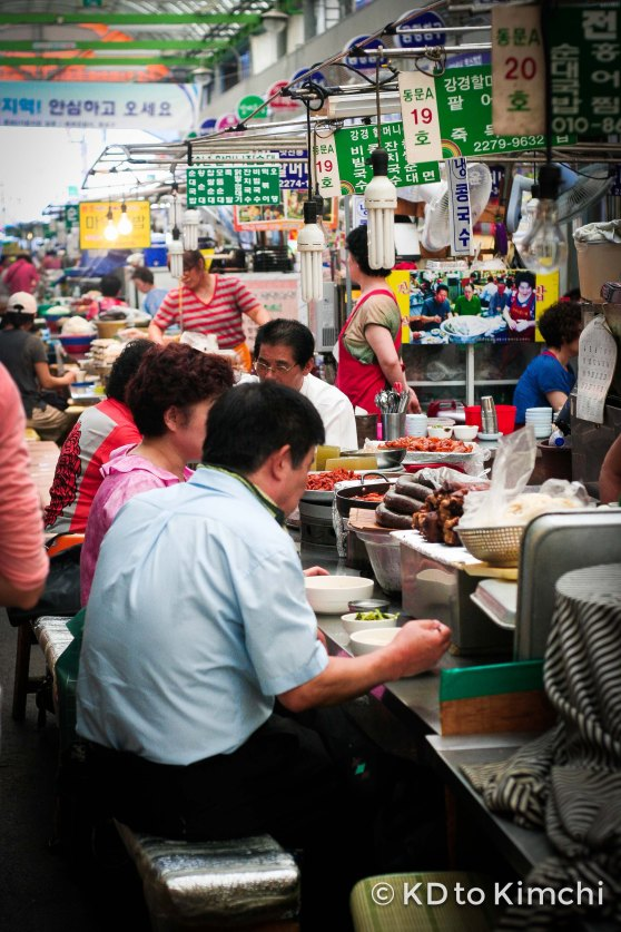 People eating at the different vendors