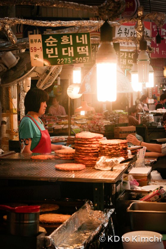 A woman selling mung bean pancake (bindatteok - 빈대떡)