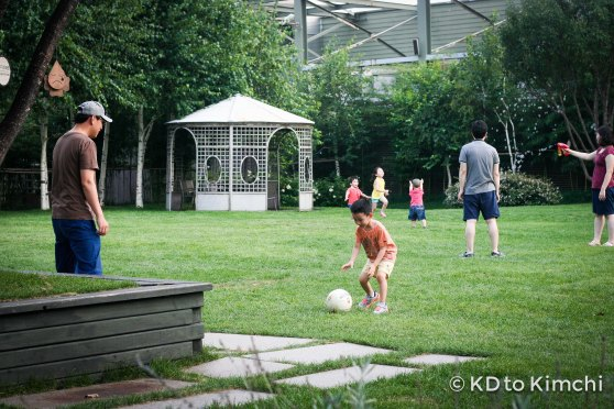 Father and son kicking a soccer ball