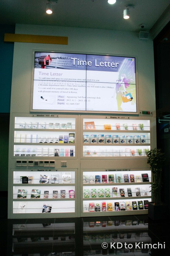 """Brochures on Gangnam attractions, and an ad for Hyundai Department Store's """"100-Day Time Letter Service"""""""